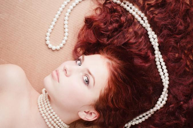redhead with pearls