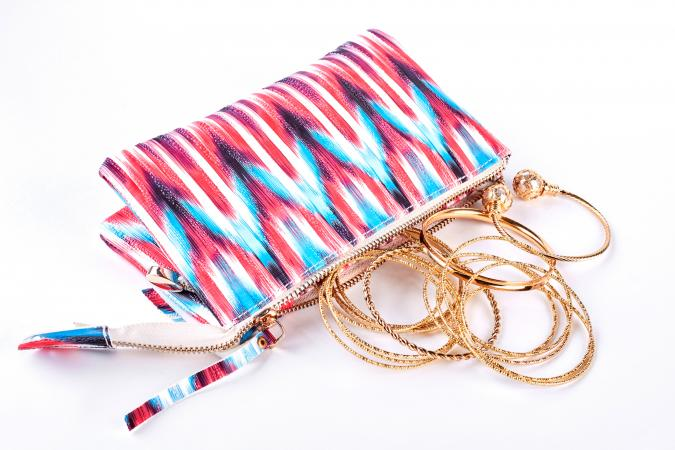 isolated jewelry bag with gold bangles