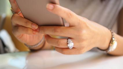 hands with diamond ring and watch