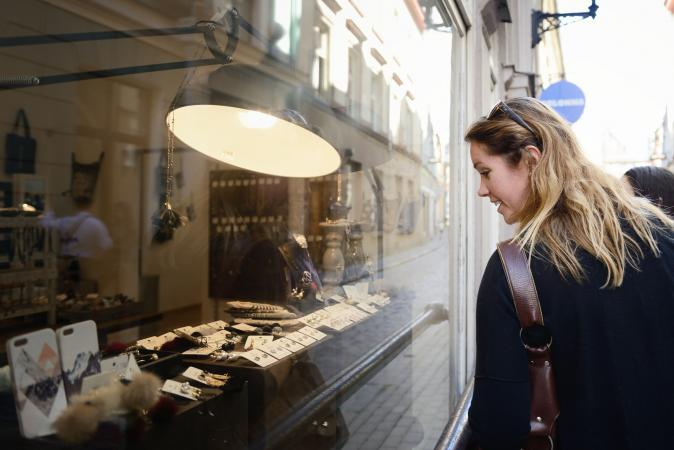 Woman looking at a jewelry display
