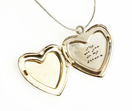 Gold locket engraved