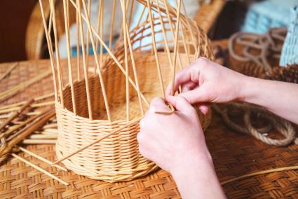 woman making wicker baskets