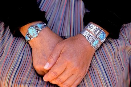 Close Up Of Hands With Turquoise & Silver Bracelets/ Getty Editorial Use