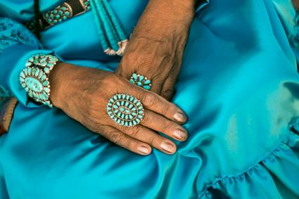 woman wearing traditional blue dress and rings