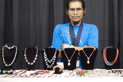 Clifton Aguilar displays his hand made jewelry / Getty Editorial Use