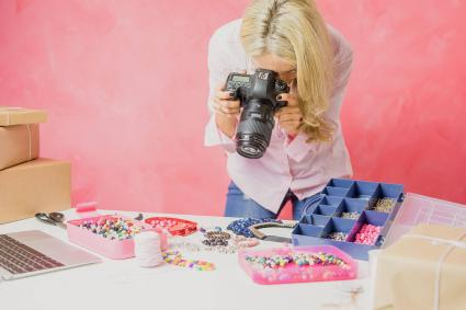 Woman taking photos of jewelry