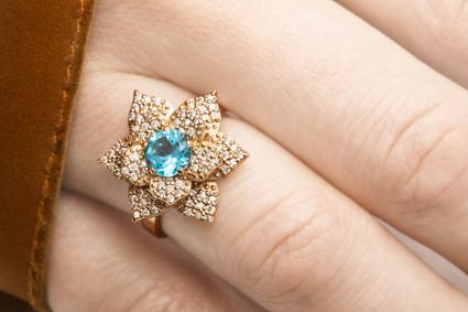 Beautiful golden ring with blue zircon gem