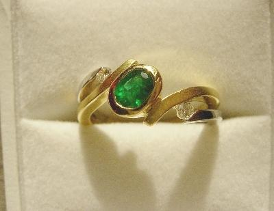 Photo of an Emerald ring in a jewelry box