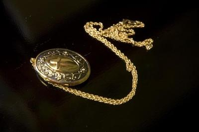 Image of an antique silver locket and chain