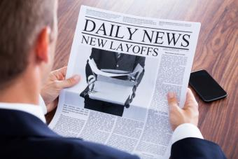 man reading news about layoffs