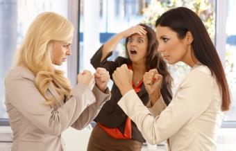 Businesswomen fighting at workplace