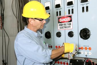 Electrician paying attention to safety with high voltage