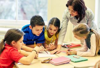 Elementary school teacher with children