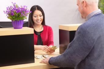 Bank teller with customer