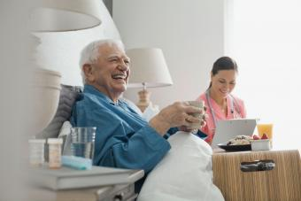 Nurse with patient in nursing home425