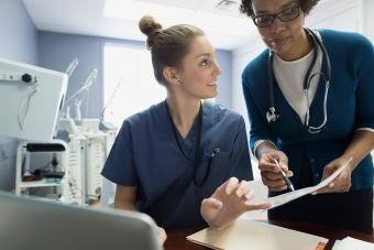 Doctor and nurse discussing medical records