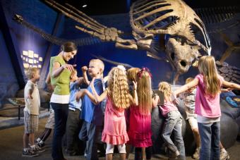 Museum worker with children at Natural History Museum