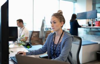 Focused businesswoman using computer