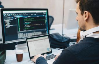 businessman programming on computers