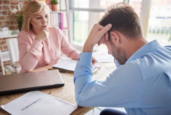 Employer reprimanding employee in office