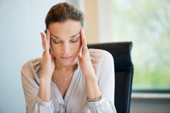 Stressed woman at her desk