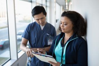 nurses looking at medical records