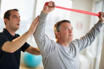Exercise physiologist helping client with stretch