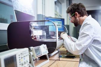 technician checking 3d printer