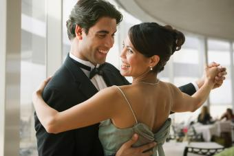 Gentleman dance host dancing with woman