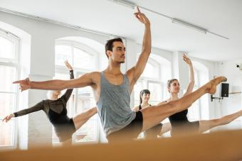 Male and female dancers practicing