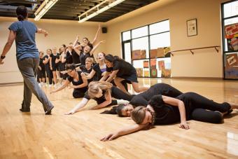 choreographer directing dancers