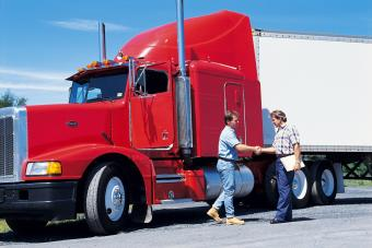 Truck driver shaking hands with client