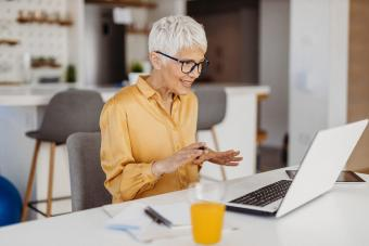 Senior woman working from her home office