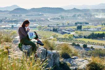 Woman explorer and geographer analyzes the environment