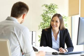 Man giving curriculum in a job interview