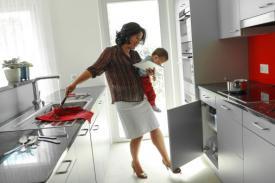 mother multitasking at home