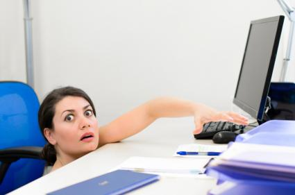 Business Woman Peeking at Computer