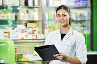 Woman pharmacist writing notes on a clipboard