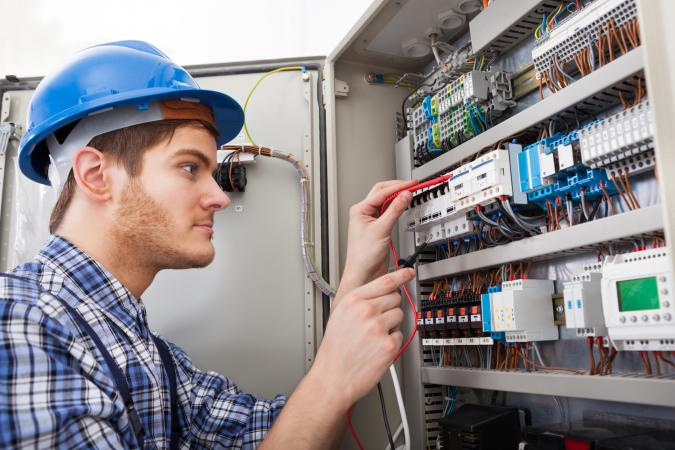 Electrician working on an electrical panel