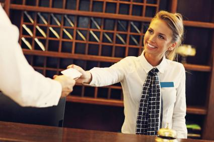 Checking in with hotel desk clerk