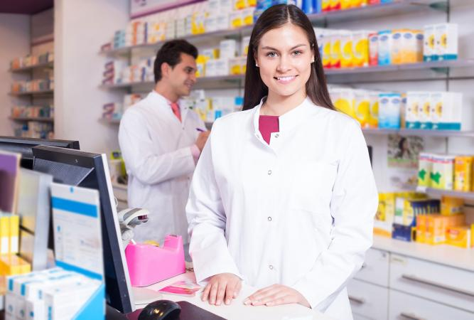 pharmacy technician at reception in drugstore