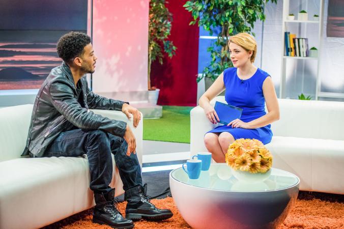 TV host interviewing guest