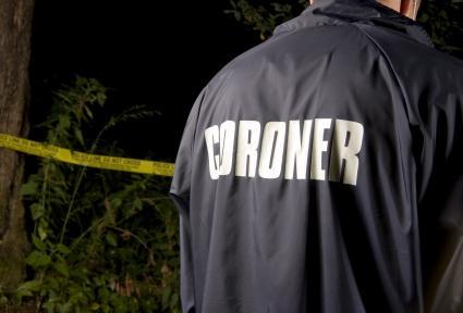 Coroner at a crime scene