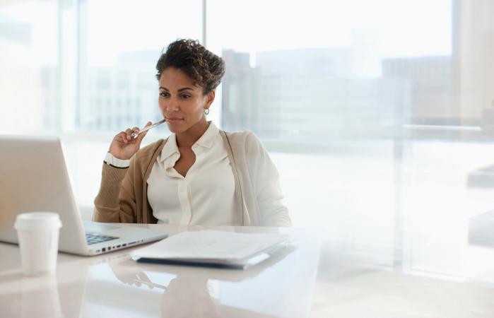 Businesswoman reading manger job description online