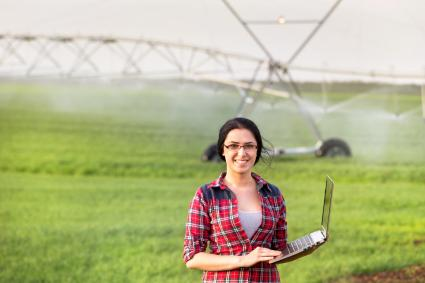 Farmer woman with irrigation equipment in field