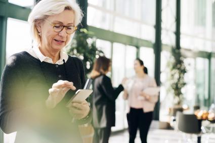 Senior entrepreneur using mobile phone