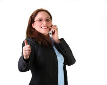 Woman on phone giving thumbs up