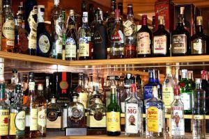 Bottles of liquor on bar shelves