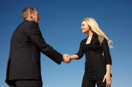 Life coach greeting job-hunting client