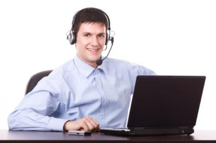 Man working at computer on headset